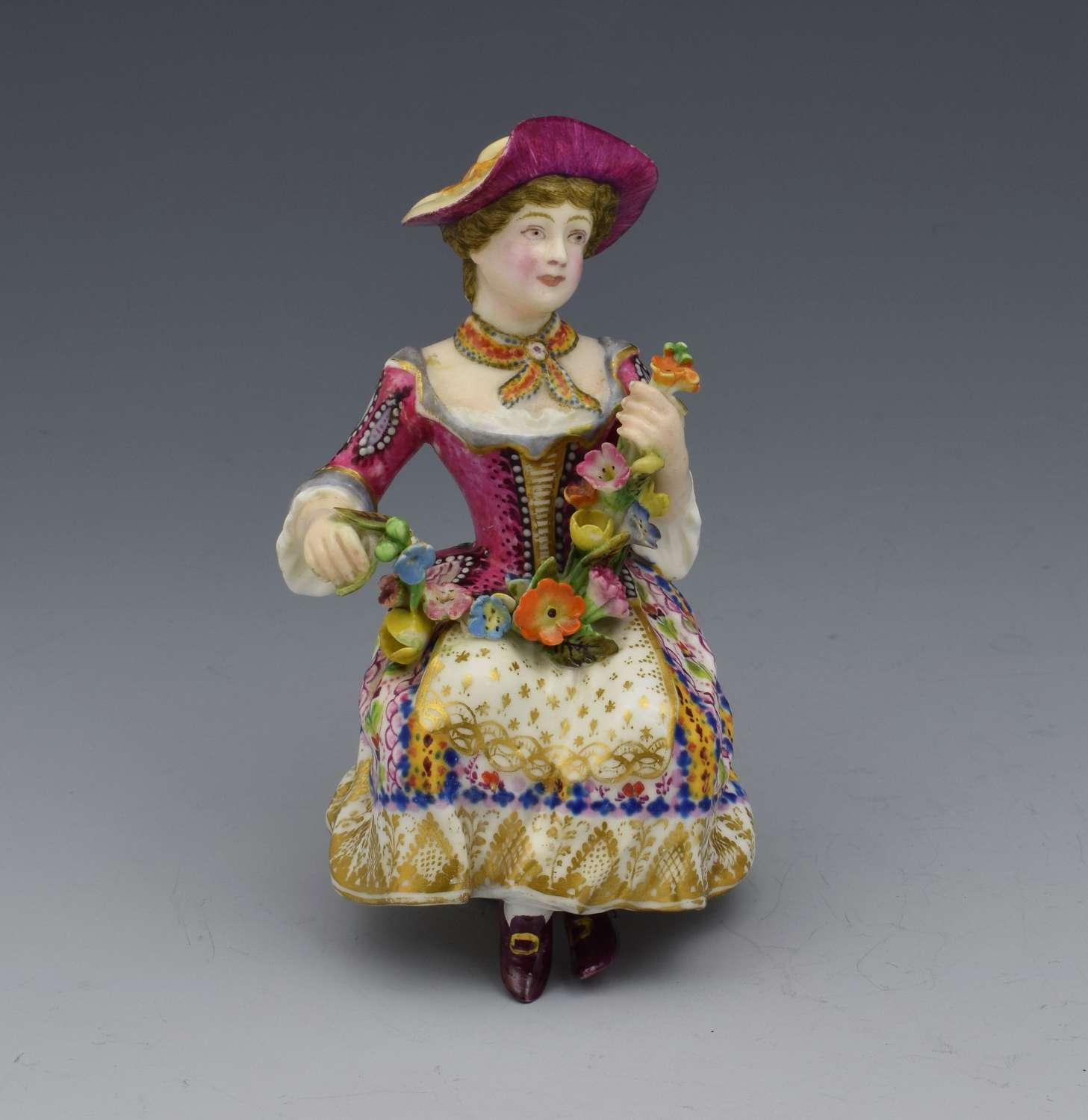 Minton Candlestick Figure Seated Flower Seller, c.1830